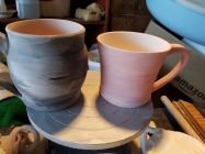 Two custom mugs that showcase color and brushtrokes.