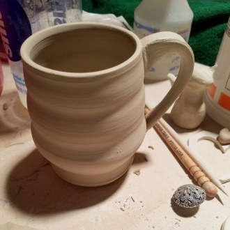 Curvy mug just after its handle was added.