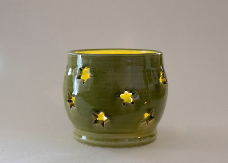 Starry tealight holder in green.